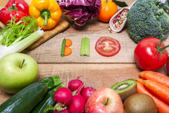 Colorful fruits and vegetables on background with word bio Royalty Free Stock Images