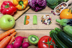 Colorful fruits and vegetables on background with word bio Stock Photos