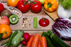 Colorful fruits and vegetables on background with word bio Royalty Free Stock Photography