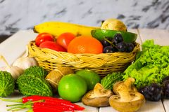 Colorful fruits and vegetables placed on the table stock photo