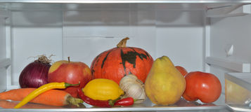Colorful fruits and vegetables in refrigerator Stock Photo