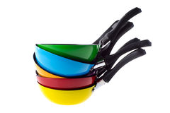 Colorful frying pans Royalty Free Stock Photos