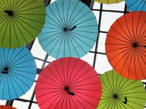 Colorful and fun decorative umbrellas in ceiling Stock Photo