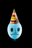 Colorful funny balloon on black background.sad birthday Stock Images
