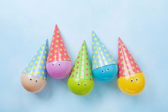Colorful funny balloons on blue table top view. Festive or party background. Flat lay. Birthday greeting card. Stock Photography