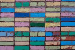 Colorful Funny Bricks. Some colorful bricks in the wall for this sunny summer Stock Image