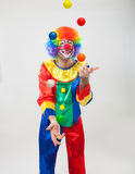 Colorful funny clown juggling balls Stock Photography