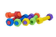Colorful and funny nuts and bolts Stock Images