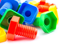 Colorful and funny nuts and bolts toys isolated Royalty Free Stock Photography