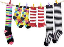 Colorful funny socks drying on the clothesline Stock Image