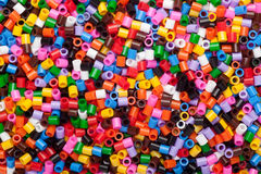 Colorful fusible plastic beads Royalty Free Stock Image