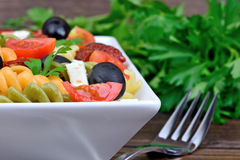 Colorful fusilli with tomato, olive, cheese and fork Royalty Free Stock Photos