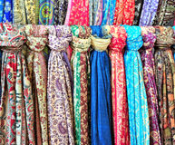 Colorful gallery of shawls in street market Stock Photos