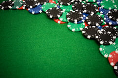 Colorful gambling chips on green felt background Stock Photography