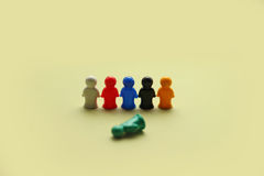 Colorful game figures. Game people symbols on yellow beige background Stock Photography