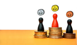 Colorful game figures symbolize a winners podium with money - with copy space and drawn medals. Concept for sport or. Drawn medals above the figures stands for Royalty Free Stock Photography