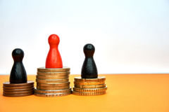 Colorful game figures symbolize a winners podium with money - with copyspace and numbers. Concept for sport or business. Royalty Free Stock Photo