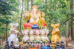 Colorful Ganesha statue in the public forest temple. Ganesha is also known as Ganapati, Vinayaka, Pillaiyar and Binayak, is one of stock photography