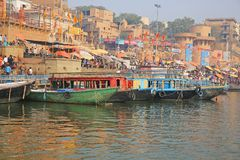 Colorful Ganges River Scene in Varanasi, India. Boats and umbrellas add color to the bank of the sacred Ganges River in Varanasi, India Stock Photos