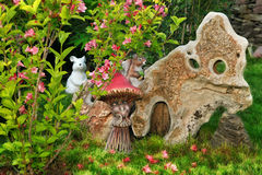 Colorful garden. With garden figures and flowers stock photography