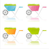 Colorful garden wheelbarrows Royalty Free Stock Photo