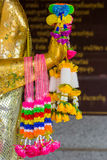 Colorful garland on buddha statue hand Royalty Free Stock Image