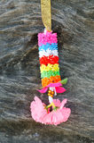 Colorful Garland. Garland made of plastic on wood Stock Image