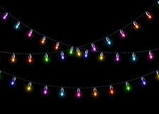 Colorful garlands on a black background Royalty Free Stock Image