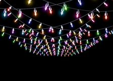 Colorful garlands on a black background Royalty Free Stock Photos