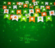 Colorful garlands of flags with clovers. Irish holiday Saint Patrick`s Day. Colorful festive bunting with clover on green background. Irish holiday - happy Saint Stock Images