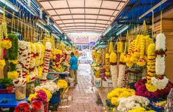 Colorful garlands flower selling in the market stalls in Brickfields Little India in KL, people can seen exploring around it. Kuala Lumpur, Malaysia - Feb 7 Stock Images