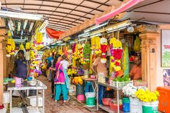 Colorful garlands flower selling in the market stalls in Brickfields Little India in KL, people can seen exploring around it. Kuala Lumpur, Malaysia - Feb 7 Stock Photos