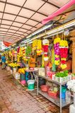Colorful garlands flower selling in the market stalls in Brickfields Little India in KL, people can seen exploring around it. Kuala Lumpur, Malaysia - Feb 7 Royalty Free Stock Photo