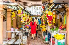 Colorful garlands flower selling in the market stalls in Brickfields Little India in KL, people can seen exploring around it. Kuala Lumpur, Malaysia - Feb 7 Royalty Free Stock Images