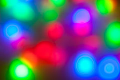 Colorful garlands of lights out of focus. Royalty Free Stock Photo