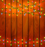 Colorful garlands on wood background Royalty Free Stock Image