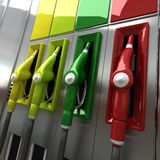 Colorful gas pumps. 3D rendering of four brightly colored gas pumps Royalty Free Stock Photos