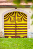 Colorful gate to the house in Holasovice, Czech Republic. Royalty Free Stock Image
