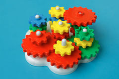 Colorful gears. Plastic toys on a blue background Royalty Free Stock Image