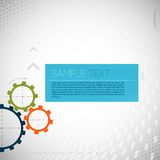 Colorful gears on gray background. Stock Photos