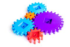 Colorful gears for ideal team work technology white table background top view. Colorful gears for ideal team work technology on white table background top view stock photos