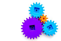 Colorful gears for ideal team work technology white table background top view mock-up. Colorful gears for ideal team work technology on white table background stock images