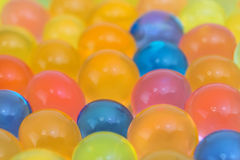 Colorful gel balls with blurred background Royalty Free Stock Photography