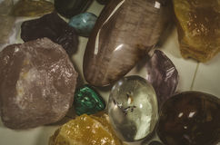 Colorful gem stones. Mixture of transparent, brown, pink and yellow gem stones Royalty Free Stock Photo