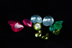 Colorful gems isolated on a black background Stock Photos