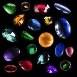 Colorful gems isolated. Group of colorful gemstones and minerals isolated over black Royalty Free Stock Images