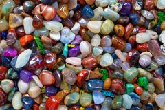 Colorful gemstones agate and opal jewellery. Pebble background stock photo
