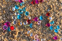 Colorful gemstones on the beach stock photos
