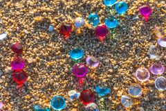 Colorful gemstones on the beach stock photography