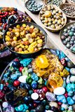 Colorful gemstones on sale at a flea market in Jerusalem, Israel. Multicolored background. Royalty Free Stock Images